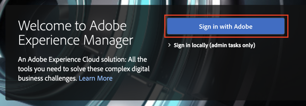 """AEM login screen with configured Adobe IMS authentication and """"Sign in with Adobe"""" button"""